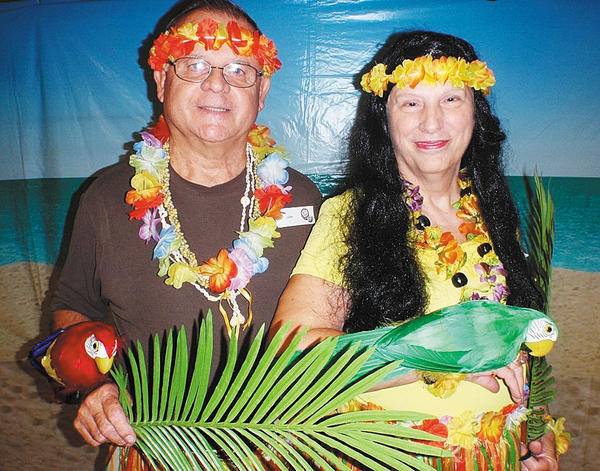 Ron and Carol Garling won the best costume contest Saturday at the Hawaiian Breeze Dance at the Maugansville Ruritan Club. The dance was hosted by the Hagerstown Country Western Dance Club.