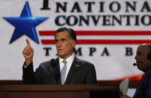 Mitt Romney prepares for his speech with stage crews before the start of the Republican National Convention in Tampa Fla.