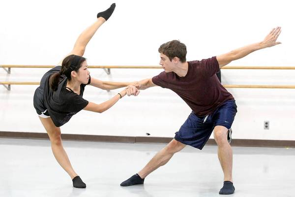 """UC Irvine dance students Andrea Yorita, left, and Alex Guthrie rehearse a scene for """"Little Orphant Annie"""" by James Whitcomb Riley on Tuesday. The piece to be performed at the Laguna Art Museum is a five-minute excerpt of the longer piece."""