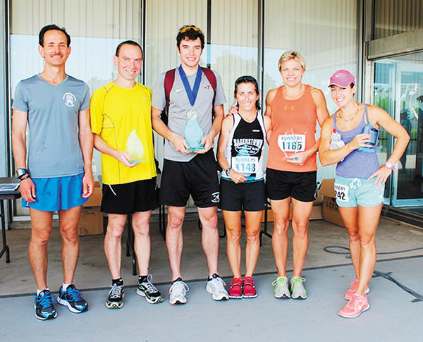 Volvo Group Hagerstown 5K top male and female finishers, from left, are Tim Fisler, Matt Elgin, Kieran Lee, Laurie Dymond, Annica Hedman and Jennifer Plevinski.