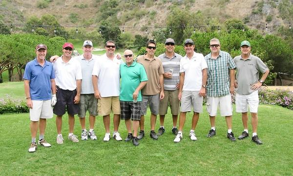 Members of the Laguna Beach High class of '82 pause at the Aliso Creek Golf Club first tee for a friendly round of golf before their class reunion Saturday. Included are Sean Quigley, Greg Gamez, Evan Chalmers, Bill Hansen, Morgan Foster, Bill Sherman, John Croul, Cullen Burgess, Bruce Waldrup, and Don Leach, left to right.
