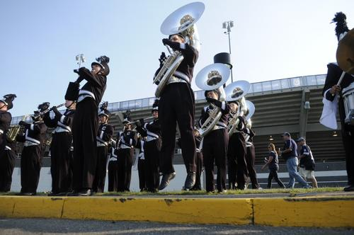 The UConn band gives some tailgaters a show prior to the start of the Huskies' football opener vs. UMass on Thursday.