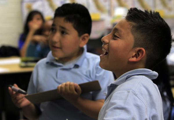 Jason Espinoza, 10, right, enjoying class at Celerity Nascent Charter School in Los Angeles.