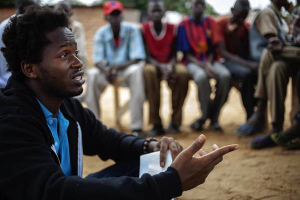 Ishmael Beah, a United Nations advocate for children affected by war, meets with recently freed child soldiers at a UNICEF center in Ndele, Central African Republic.