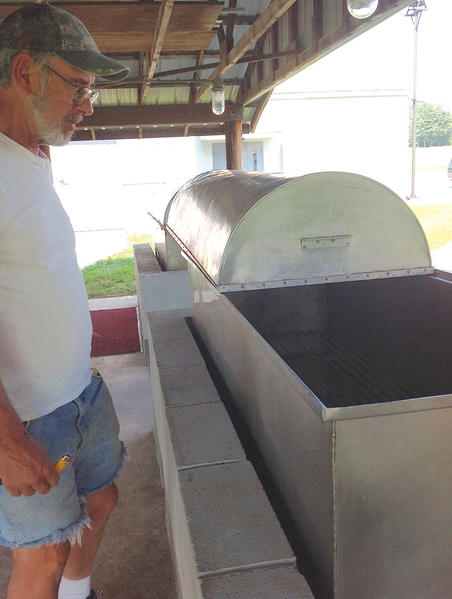 Donny Gossert of Quincy Township, Pa., prepares roasters for this weekend's 78th annual Quincy Ox Roast. More than 2,200 pounds of beef will be cooked.