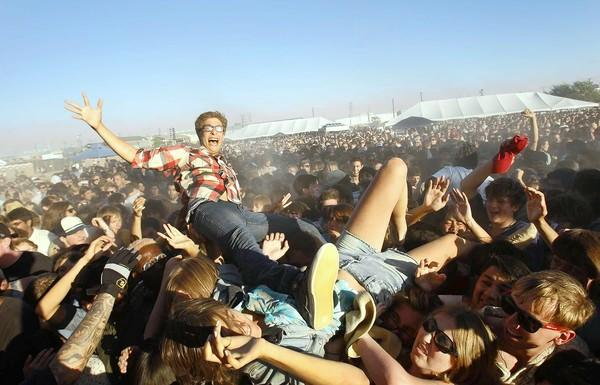 Fans float over the mosh pit during No Age's performance at FYF Fest, at L.A. State Historic Park in Los Angeles on Sept. 3, 2011.