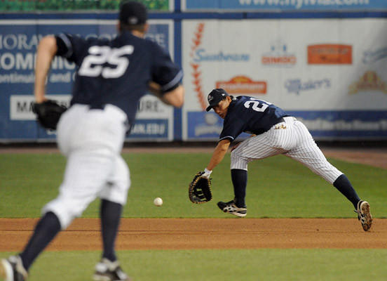Scranton/Wilkes-Barre Yankees' infielder Kosuke Fukudome (21) (right) fields a ground ball at first base during their game with the Lehigh Valley IronPigs at Coca-Cola park in Allentown Thursday night.
