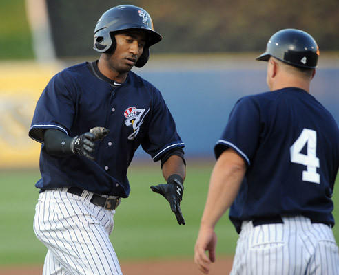 Scranton/Wilkes-Barre Yankees' Eduardo Nunez (26) (left) is congratulated by third base coach Frank Menechino (4) (right) after hitting a two run home run during their game with the Lehigh Valley IronPigs at Coca-Cola park in Allentown Thursday night.