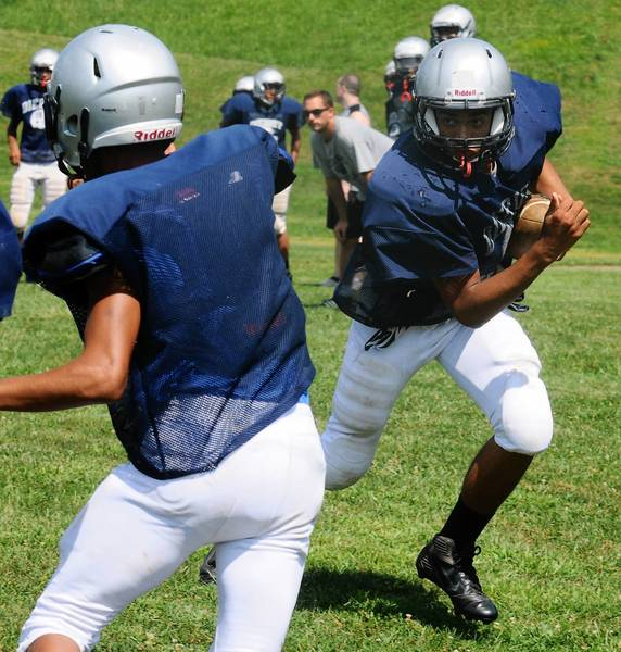 Kacey Meyers runs the ball during a recent football practice at Dieruff High School.