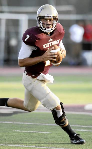 Kutztown University quarterback #7 Kevin Morton looks for a receiver against St. Anselm on Thursday night.