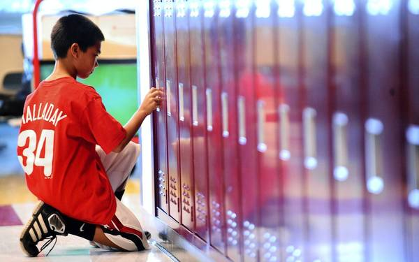 Austin Brockel, a new sixth grader at Orefield Middle School, tries out his locker for the first time.
