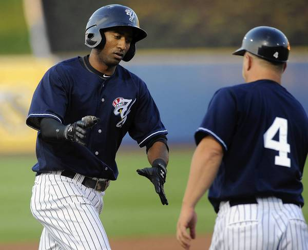 Scranton/Wilkes-Barre Yankees' Eduardo Nunez (26) (left) is congratulated by third base coach Frank Menechino (4) (right) after hitting a two-run home run during their game with the Lehigh Valley IronPigs at Coca-Cola park in Allentown Thursday night.