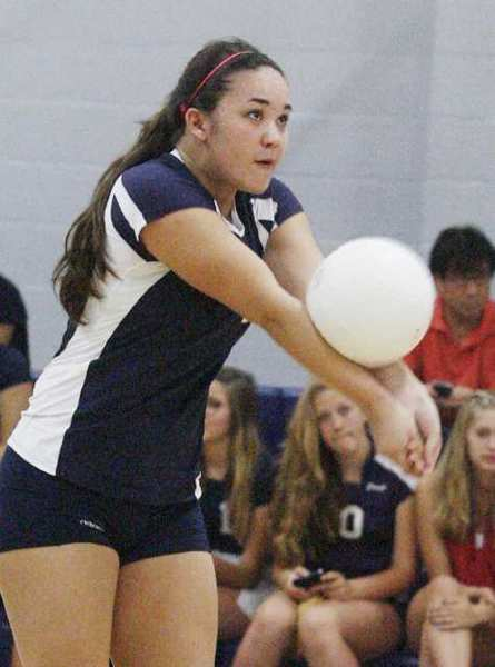 Flintridge Prep's Danielle Lincoln bumps the ball off a Holy Family serve.