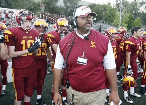 La Cañada High's head football coach James Sims on the sidelines in his debut against Alhambra.