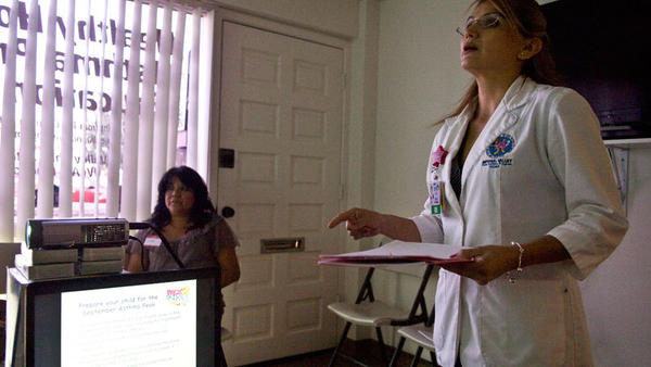 Aide Munguia-Fulton, Imperial Valley Child Asthma Program director, leads a group of parents through an informative workshop on asthma Thursday afternoon in El Centro.