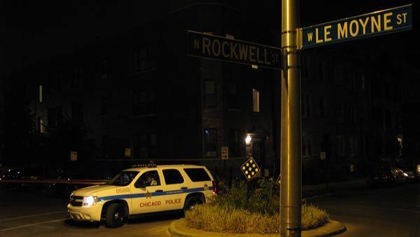 A Chicago Police Department sergeant guards the 2600 block of West Le Moyne Street in the Humboldt Park neighborhood early Aug. 31. Two men were shot here about 3:50 a.m.