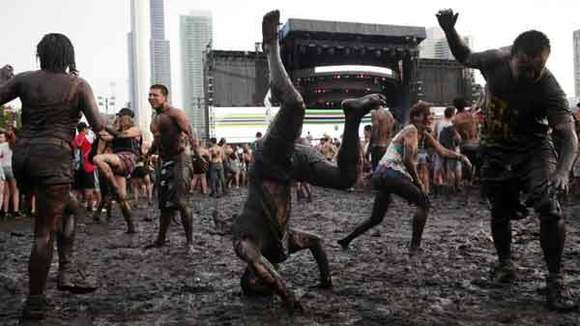 Concert-goers dance in the mud during Calvin Harris's performance at Lollapalooza in August.