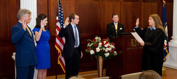 From left, Mark Bryant, Kelly Holland and Stephen Bilas are sworn in as members of the University of Kentucky board of trustees by Jefferson District Judge Jennifer Bryant Wilcox. Wilcox is Bryant¿s daughter.