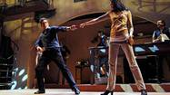 "Rick Bayless  and Chiara Mangiameli dance during a rehearsal of ""Cascabel"" at Lookingglass Theatre."