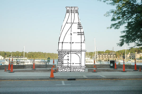 This photo illustration was created using a photograph taken Wednesday from a parked car across Bridge Street from the location where the outdoor fireplace in East Park's Plaza B is currently under construction. The photograph was merged with the original fireplace drawing presented to the city council. The drawing's size was scaled so that the base of the drawing matches the foundation pad that was poured at the site on Wednesday, Aug 29.