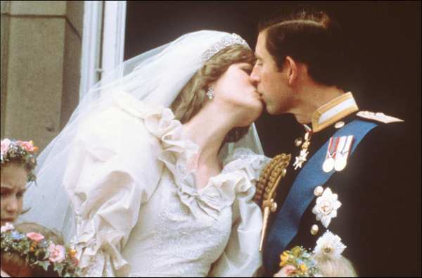 Prince Charles, prince of Wales, and Princess Diana kiss during their wedding in London on July 29, 1981. Diana died in a car crash in a Parisian road tunnel on Aug. 31, 1997.