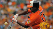 Xavier Avery and Luis Exposito with Orioles in New York
