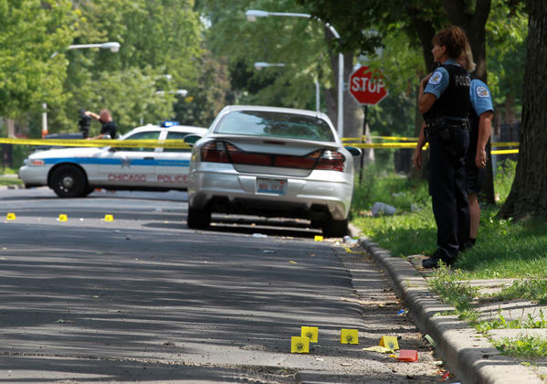 Police evidence labels mark the scene of a shooting in the 4200 block of West Wilcox Street where a teenage girl was shot but not seriously injured as she walked home from school.