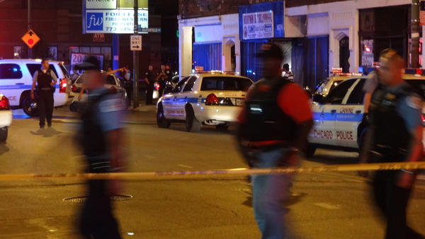 Chicago police work the scene of a shooting in the 7800 block of south Marshfield Avenue.
