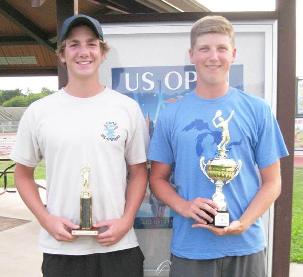 Petoskey's Zach Phillips (left) and Cam Ludlow display the trophies they earned Thursday by placing first at No. 1 and No. 2 singles, respectively, at the Up North Invitational at Traverse City Central.