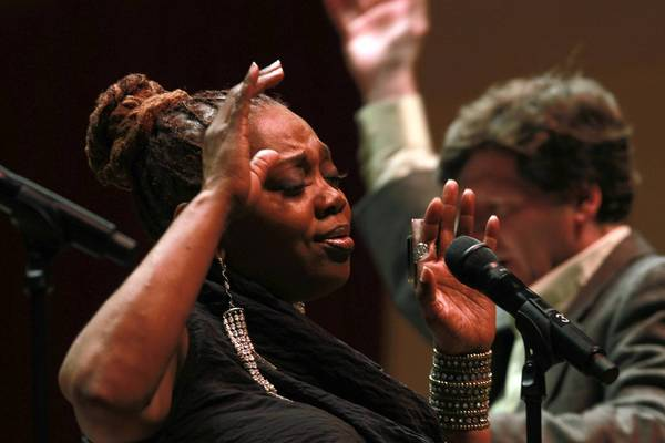 In a tribute to Ella Fitzgerald vocalist Dee Alexander performs as Jeff Lindberg conducts the Chicago Jazz Orchestra during opening night of the Chicago Jazz Festival.