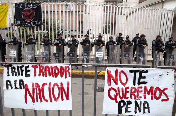 Police officers stand guard Friday during a demonstration outside the Federal Electoral Tribunal in Mexico City.