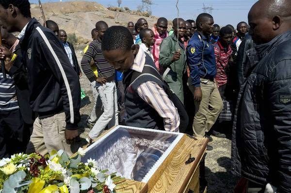 Miners attend a funeral for strikers killed by police on Aug. 16 at the Lonmin company platinum mine in Marikana, South Africa.