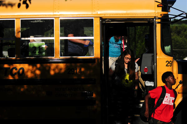 Students arrive at Woodrow Wilson Middle School in Middletown on their first day back last Thursday.