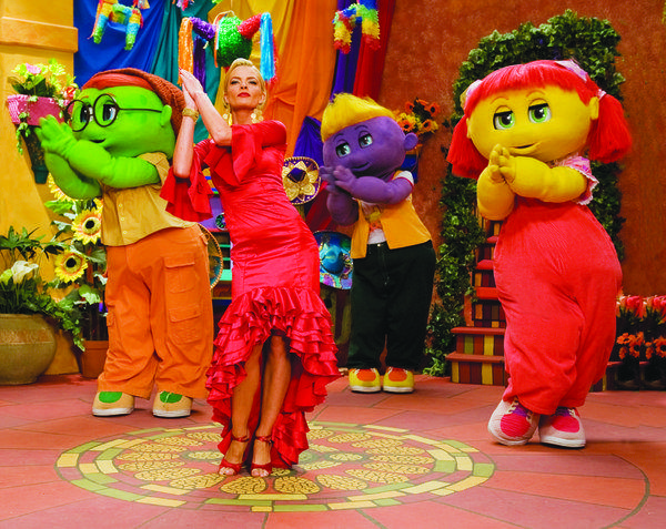 "Jaime Pressly dances with the Oogieloves from the movie ""Oogieloves and the Big Balloon Adventure."""