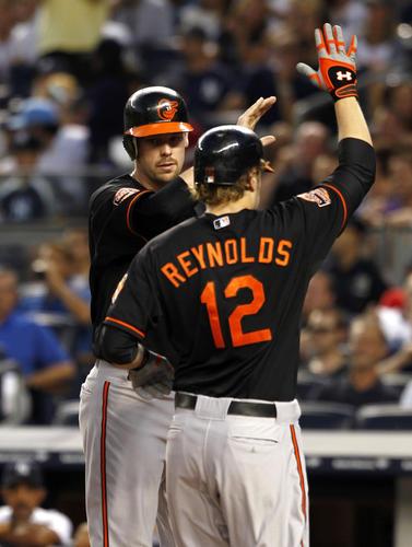 Matt Wieters greets Baltimore Orioles first baseman Mark Reynolds after his 2-run homer against the New York Yankees.