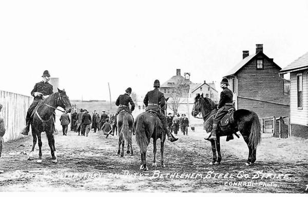 During the 1910 strike at Bethlehem Steel, Pennsylvania State Constabulary officers patrolled on horseback. A worker was shot and killed during the strike. A historic marker commemorating the strike will be dedicated on Saturday.