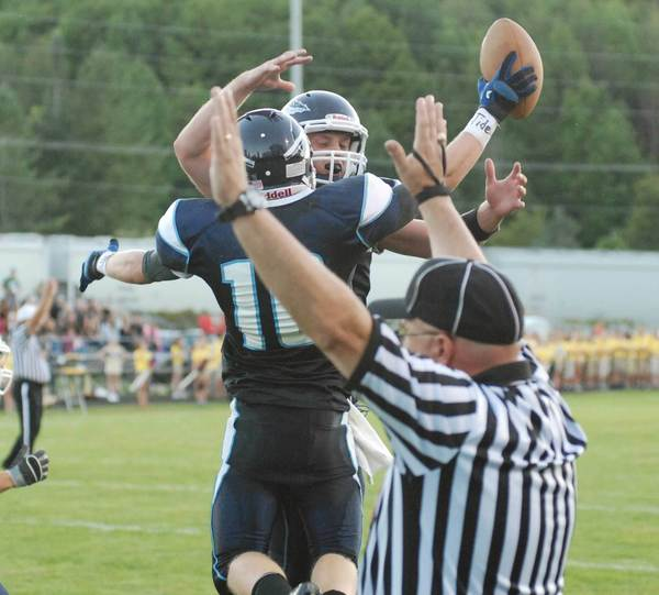 Petoskey quarterback Quinn Ameel (facing camera) and receiver Tony DeAgostino celebrate after DeAgostino's touchdown reception with under 5 seconds remaining in the first half on Friday of a 34-8 victory over West Branch Ogemaw Heights.