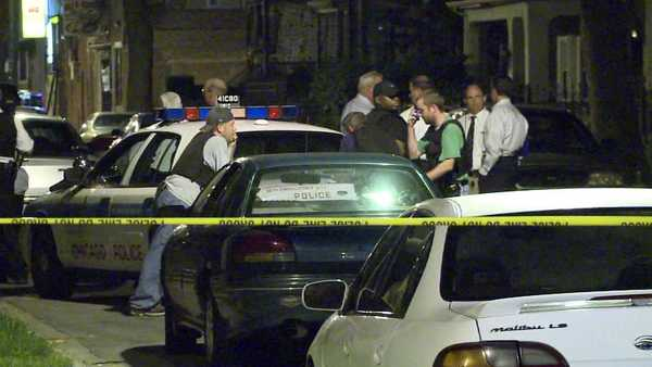 Chicago police on the scene of a shooting in the West Woodlawn neighborhood.