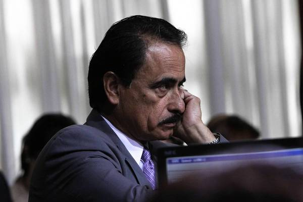 Richard Alarcon listens at a Los Angeles City Council meeting in 2011. A cousin and staff member testified at Alarcon's perjury and fraud trial that the veteran politician moved into his Panorama City home within 30 days of his election to the state Assembly in November 2006.