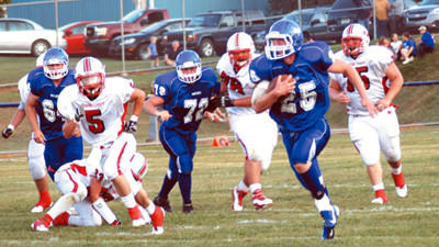 Berlin's Drew Glotfelty heads down the sideline for a 63-yard touchdown run during first quarter action against Conemaugh Township Friday.