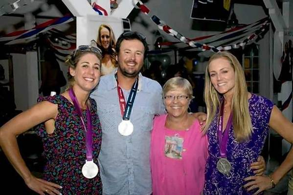 Volleyball star April Ross-Keenan, Coach Jeff Conover, hostess Sherry Rorden and volleyball champion Jen Kessy at the Costa Mesa block party honoring the Olympians.