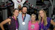 It was a block party with a very special silver lining. An Olympic silver medal lining to be exact.