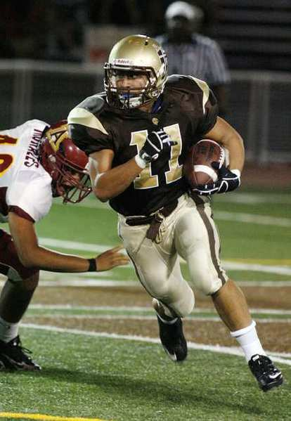 St. Francis' Daniel Kawamura carries the ball in the first quarter against Arcadia.
