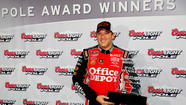 Defending Sprint Cup champion Tony Stewart has claimed the pole for Sunday night's NASCAR race at Atlanta Motor Speedway.