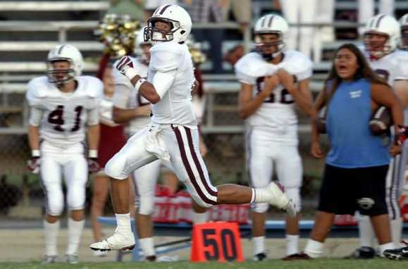 Laguna Beach High's Robert Clemens crosses the 50-yard line marker as he returns the kickoff for a touchdown during the first quarter against Bolsa Grande on Friday.