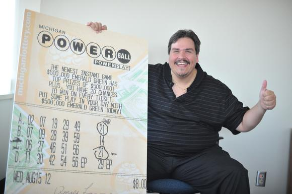 Donald Lawson, of Lapeer, Mich., with his winning ticket (enlarged).