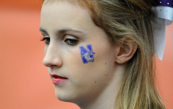 Northwestern Wildcats cheerleader looks on prior to the game against the Syracuse Orange at the Carrier Dome.