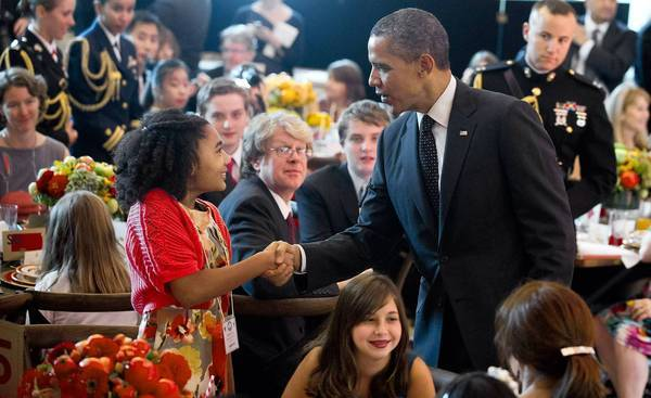 "President Obama greets guests of a ""Kids' State Dinner"" last week hosted by First Lady Michelle Obama. The president has said he counts his failure to bridge the nation's partisan gap as one of his biggest frustrations."