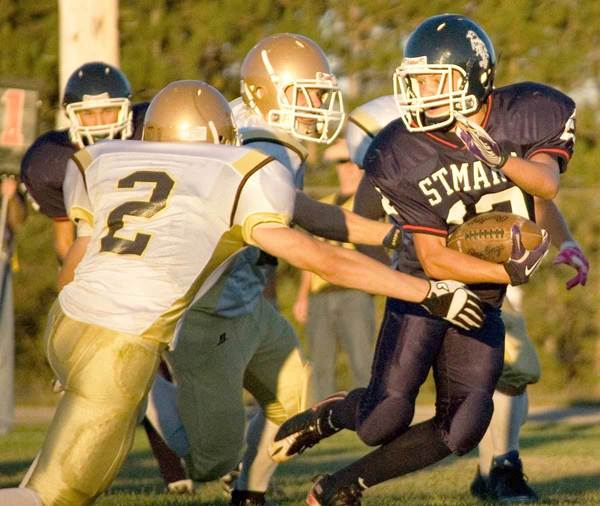 Pellston's Chase Woods (2) tries to corrall a Gaylord St. Mary running back Friday in a 31-18 victory. The win lifted Pellston to 2-0 on the season, its first 2-0 start since 2002.