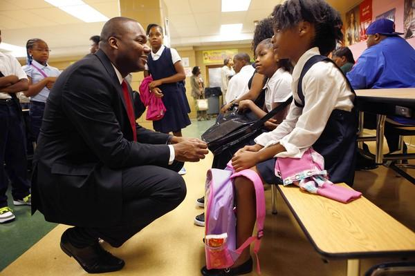 Chicago Public Schools chief Jean-Claude Brizard talks with students Aug. 13, the first day of classes at Bond Elementary School on the South Side. Unlike Bond students, most CPS students will begin their school year Tuesday.